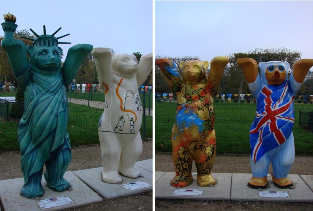 Левый мишка на первом фото - американец в наряде статуи Свободы. Левый мишка на втором фото - русский в виде матрешки.