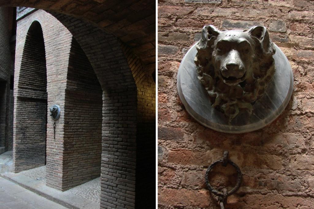 Дворец Гуэля. Подвальный этаж с бывшими конюшнями. Параболическая аркада. Маскарон в виде собачьей морды.