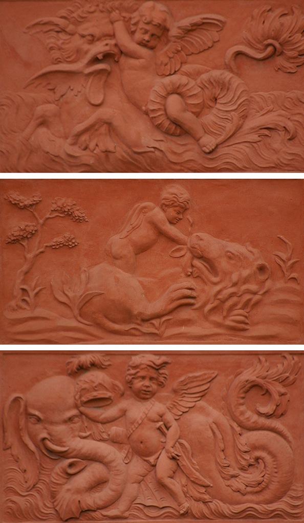 "Петербург. Летний сад. Ле́тний дворе́ц Петра́ I. Межоконные барельефы. ""Амур с морским львом"" Межоконные барельефы. ""Бог Марс с морским слоном"""