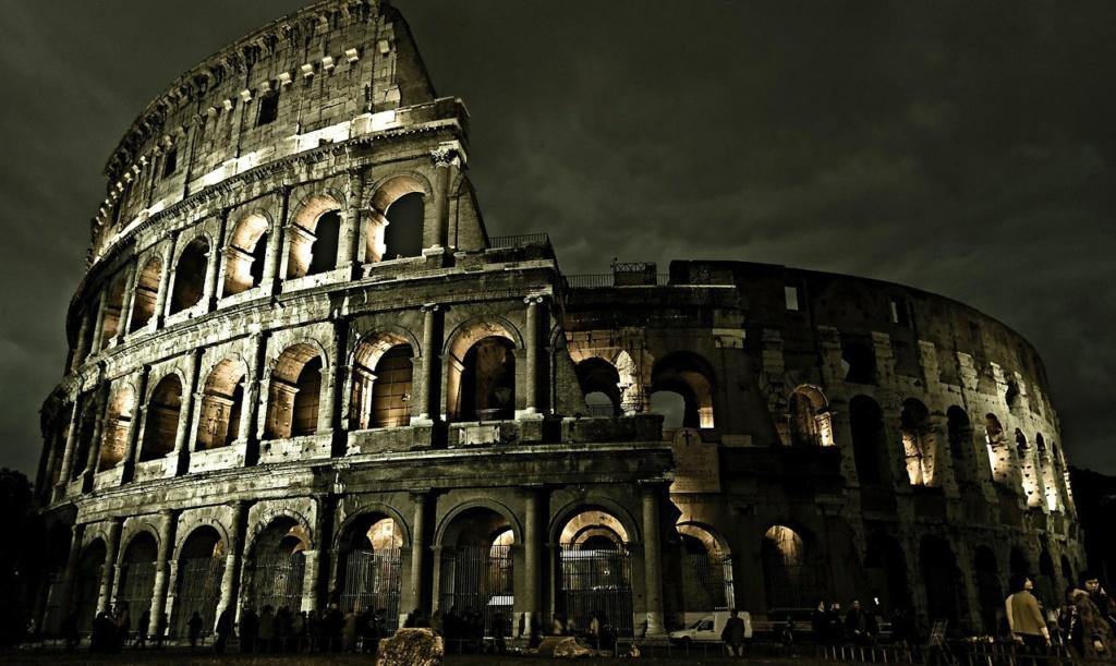 Колизей (громадный, колоссальный) или амфитеатр Флавиев, возведенный в I веке Новой эры. То - СИМВОЛ ТОРЖЕСТВУЮЩЕЙ ЖЕСТОКОСТИ, ПРЕВРАЩЕННОЙ В ПРАЗДНИК. Днем руины молчат. В ночи наполняются призраками былого, стоны которых страшны...